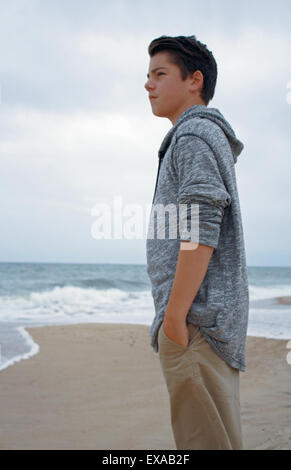 Boy Standing on Beach along Atlantic Ocean Montauk Long Island New York - Stock Photo