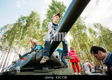 SVIETLAHORSK, BELARUS - JUNE 21, 2014: Children climb on Soviet tank from World War II during celebration events - Stock Photo