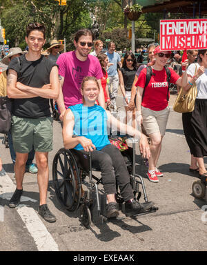 New York, USA. 12th July, 2015. People with disabilities and their supporters march down Broadway from Madison Square - Stock Photo