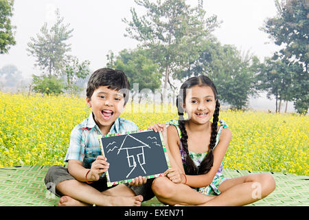 2 Rural kids Brother and sister farm Slate board showing - Stock Photo