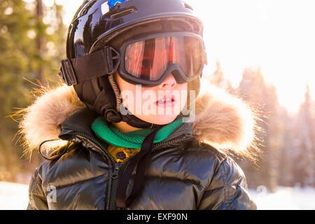 Close up portrait of boy wearing helmet and goggles, Nizhniy Tagil, Sverdlovsk Region, Russia - Stock Photo
