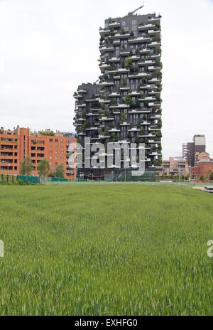 Bosco Verticale buildings and wheat field in Milan, Italy - Stock Photo