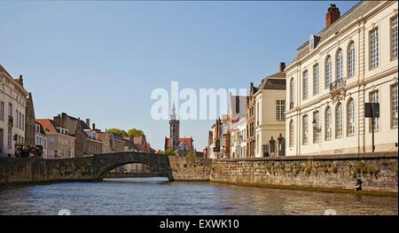 Jan van Eyck Statue and channel in Bruges, Belgium - Stock Photo