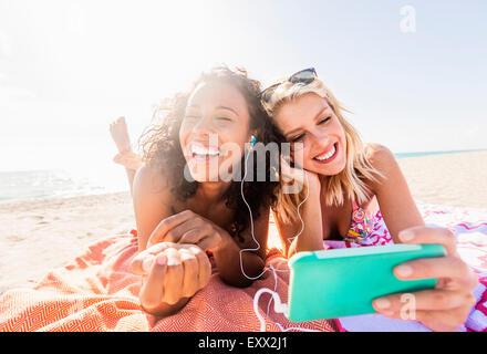 Female friends on beach - Stock Photo