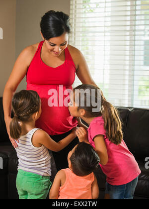 Pregnant mother and children (2-3, 6-7, 8-9) - Stock Photo