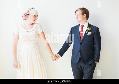 Smiling newlywed couple in studio - Stock Photo