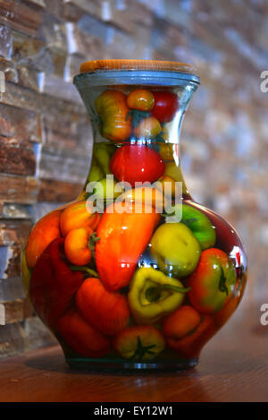 Jar of preserved peppers. - Stock Photo