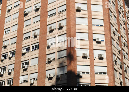 A tower block with several air conditioners on a hot summer day in Zaragoza, Spain. - Stock Photo