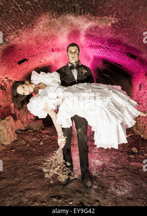 Couple dressed in costumes at Halloween; Tarifa, Cadiz, Andalusia, Spain - Stockfoto
