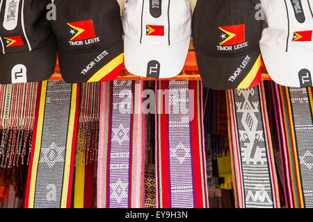 Hats and Timorese textiles for sale at Dili Tais Market; Dili, East Timor - Stock Photo