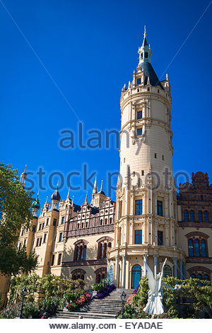 The tower and a small part of the garden of Schwerin Castle (Schweriner Schloss) - Stock Photo