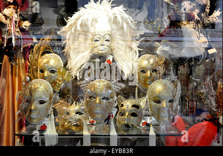 Italy  - Venice - window display - exotic Venetian Carnival masks - mock gold - silver  feathers decorations - mystical - Stock Photo