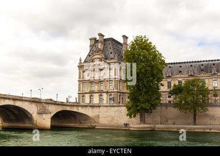 View of the Louvre Museum and Ecole du Louvre from the Seine River with Pont Royal Bridge in the foreground, Paris - Stock Photo