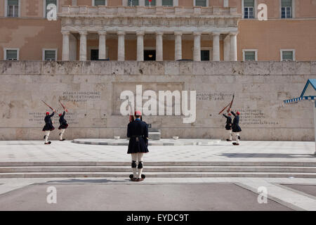 Evzones changing the guards at the tomb of the unknown soldier in Syntagma square, wearing winter (dark blue) outfit. - Stock Photo