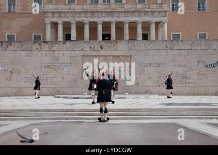 Tsoliades/ Evzones changing the guards at the tomb of the unknown soldier in Syntagma square, wearing winter (dark - Stock Photo