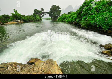 Beautiful Li river side Karst mountain landscape in Yangshuo Guilin, China - Stock Photo