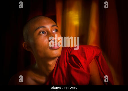 Portrait of a monk at Myanmar Monastery; Yangoon, Myanmar - Stock Photo