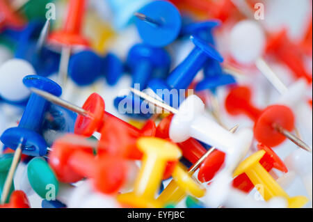 Close-up of a collection of colourful drawing-pins. - Stock Photo