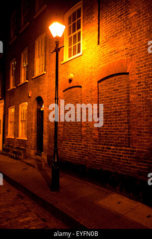 Old Fashioned Street Light And Victorian Building In The