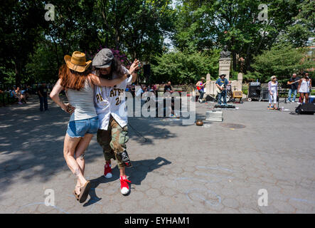 New York, NY- 26 July 2015 - Man and woman dance to a rock band in Washington Square Park  ©Stacy Walsh Rosenstock/Alamy - Stock Photo