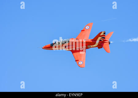 Single Royal Air Force Red Arrows Hawk aircraft during an airshow diplay - Stock Photo
