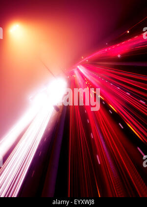 Colorful light trails of busy highway traffic on a foggy night, Highway 401, Toronto, Ontario, Canada. - Stockfoto