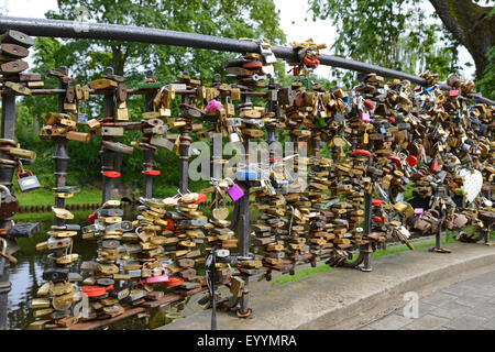 love locks at a bridge , Latvia, Riga - Stock Photo