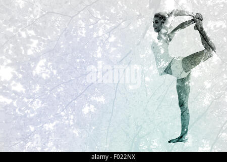 Composite image of sporty woman stretching body while balancing on one leg - Stock Photo