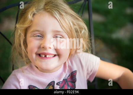Portrait of a girl with toothy smile - Stock Photo