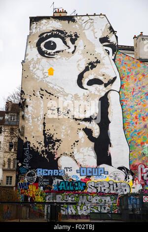 Man Shushing graffiti near the Pompidou centre, Paris - Stock Photo