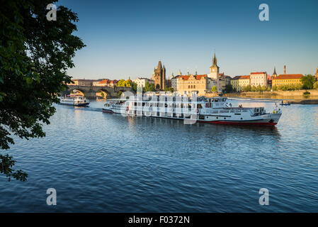 View on Charles bridge and Vltava river with tourist boat, Prague, Czech republic, Europe - Stock Photo