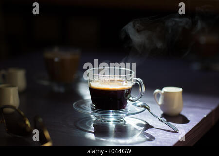 cup of hot coffee on the table - Stock Photo