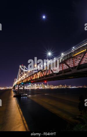 San Francisco-Oakland Bay Bridge and cityscape at night - Stock Photo