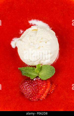red strawberry soup with ice-cream and mint leafs - Stock Photo