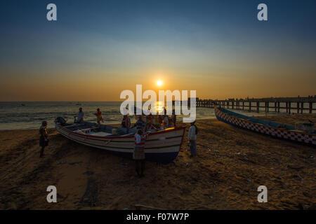 Fishermen at beach side on evening sunset time, south india,kerala - Stockfoto