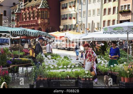 People in market stalls at Cathedral Square in Freiburg, Black Forest, Germany - Stock Photo