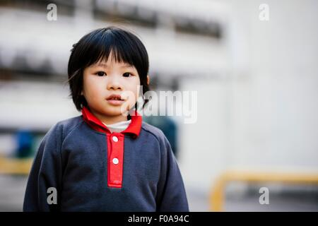 Portrait of boy looking at camera - Stock Photo