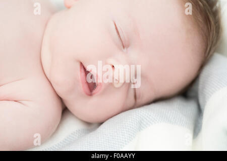 Close up of baby sleeping - Stock Photo