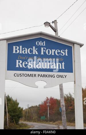 Signboard of Old Black Forest on road in Lunenburg, Nova Scotia, Canada - Stock Photo