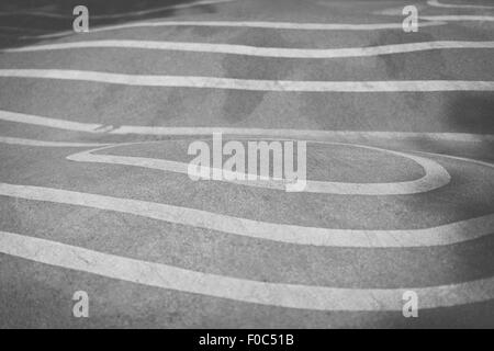 Full frame shot of asphalt with white markings - Stock Photo