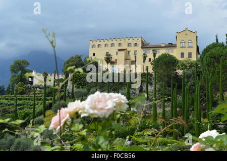Air view on the botanical gardens castle Trauttmansdorff and parts of Merano in South Tyrol - Stock Photo