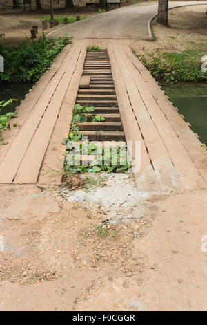 Wooden bridge over the canal - Stock Photo