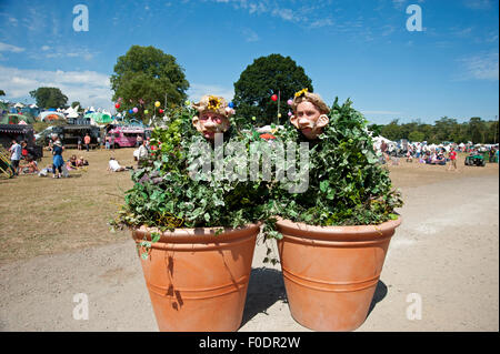 Two street actors dressed up as plants in pots at the Port Eliot Festival Cornwall - Stock Photo