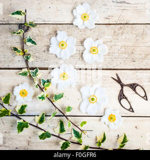 japanese anemones with scissors and ivy - Stock Photo