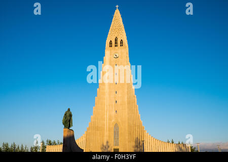 The Hallgrimskirkja and the statue of Leif Eriksson in Reykjavik, Iceland - Stock Photo