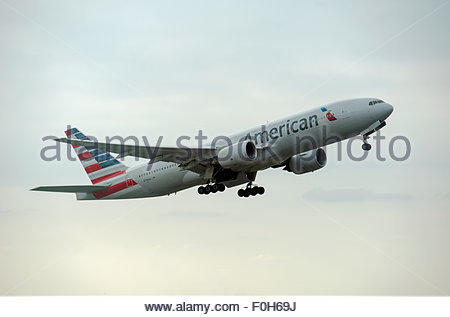 London UK. American Airlines Boeing 777 N799AN aircraft taking off from London Heathrow Airport. - Stock Photo