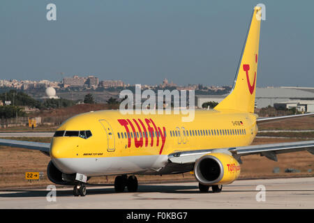 TUIfly Boeing 737-800 passenger jet plane taxiing for departure from Malta - Stock Photo