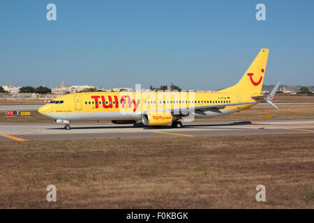 Technology in commercial aviation. TUIfly Boeing 737-800 with the new split scimitar winglets taxiing for departure - Stock Photo