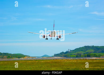 Twin-engine, modern, big commercial airliner coming for a landing at an airport - Stock Photo