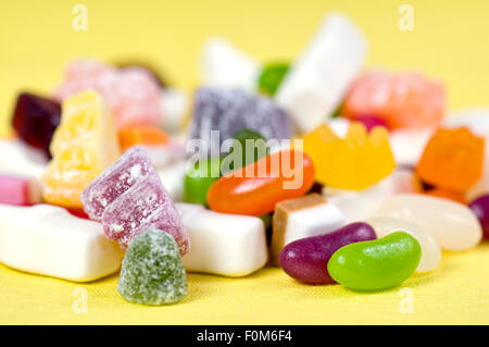 Mixture of childrens sweets including gummy bears, jelly beans, dolly mixtures, jelly babies and milk bottles - Stock Photo